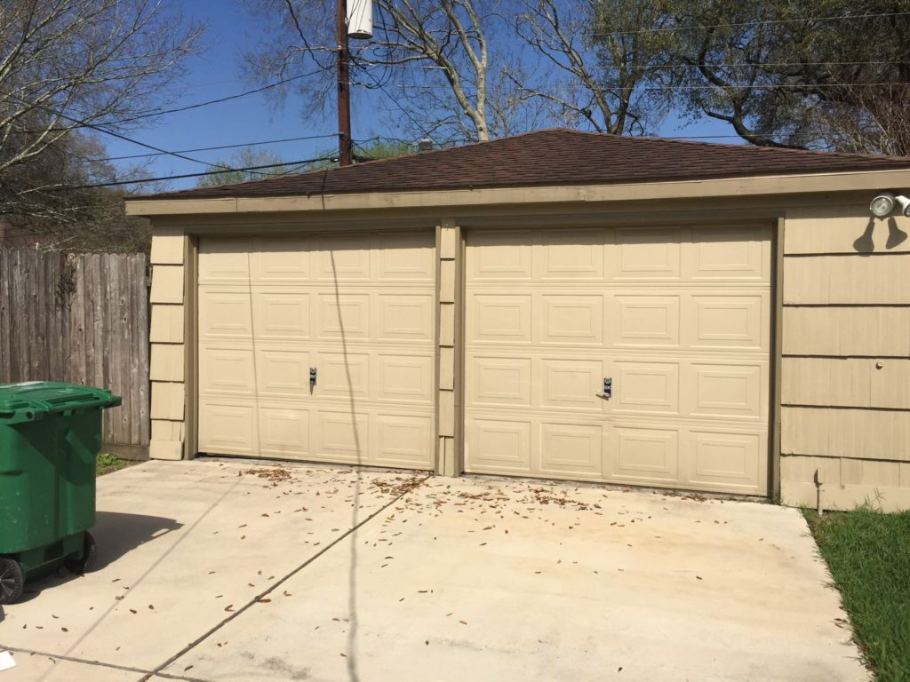 before- 2 garage door to 1 conversion