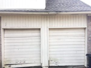 2 garage doors into 1-before